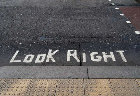 look at right: Look right road warning, danger sign. Political metaphor maybe.