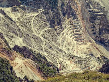 carrara: Carrara marble quarries, Italy. Retro filtered image. Stock Photo