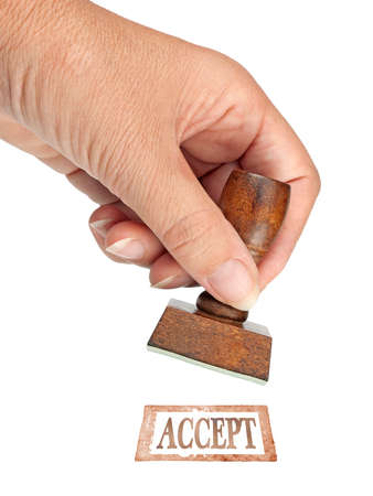 acceptance: Hand with rubber stamp of approval acceptance. Business etc. Stock Photo