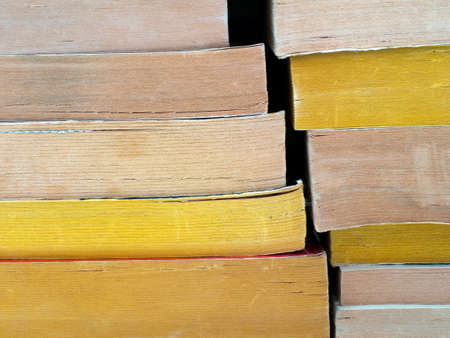 paperback: Yellowing old paperback books. Obsolete. Stock Photo