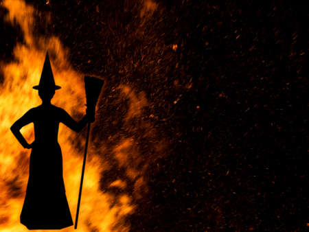 broomstick: Witch by fire with broomstick. Silhouette slightly blurredfor effect.