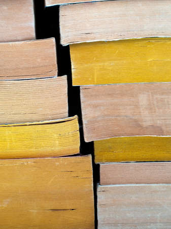 paperback: Faded paperback books stack. Stock Photo