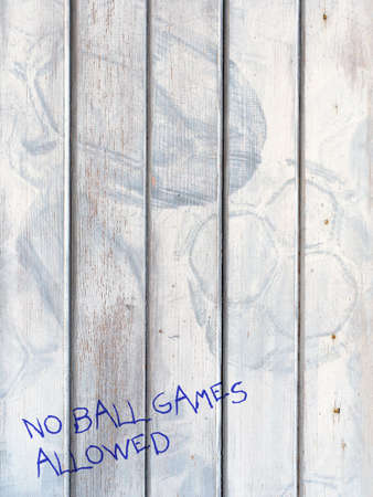 No ball games on door stained by balls.