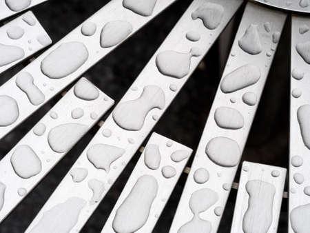 aluminium: Raindrop shapes on aluminium bench detail. Abstract.