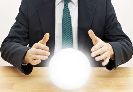 crystal ball: Strategic planning businessman. Or accountant doing budget with crystal ball.