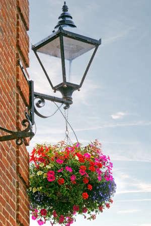 hanging basket: Traditional English street decoration - lamp and hanging basket of flowers