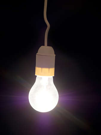 enlighten: Frosted glass retro light bulb with rays.