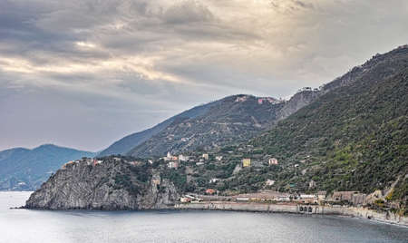 understated: Corniglia village in the Cinque Terre. Great sky on wintry day. Stock Photo