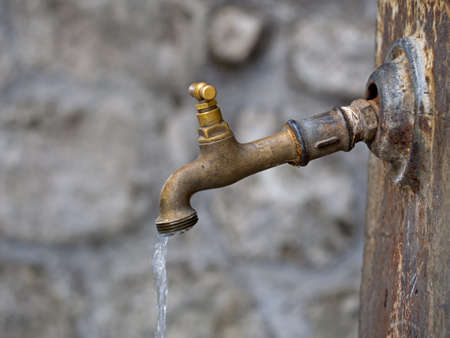 water concept: Old rusty fountain. Drooping, dripping.