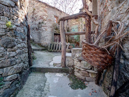 forlorn: Abandoned hill village, Lunigiana, Italy, with basket.