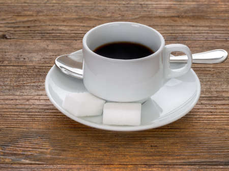 cup and saucer: Espresso coffee. White cup, saucer.