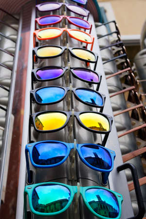 low angles: Sunglasses. Interesting composition with reflections of Italy - Monterosso, Liguria! Stock Photo