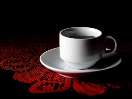 doily: Strong dark coffee, red lace doily