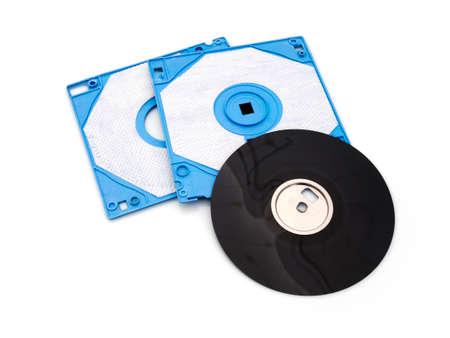 obsolete: Obsolete technology old floppy disc. Blue plastic. White background. Stock Photo