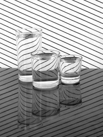 Glasses of water with refraction, reflection. Stock Photo