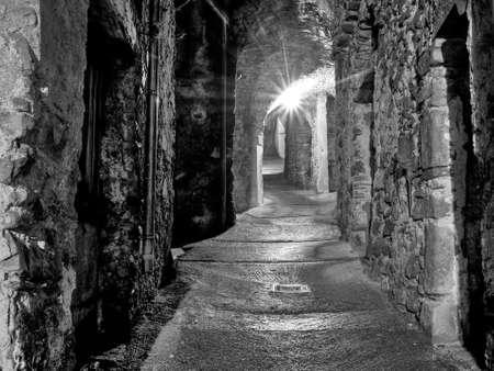 mediaeval: Monochrome alley in medieval Italian village. One light.
