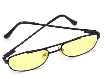 dyslexia: Dyslexia yellow lens glasses, on white.