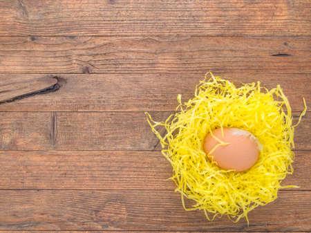paper basket: Easter hens egg in paper basket. Fragile.