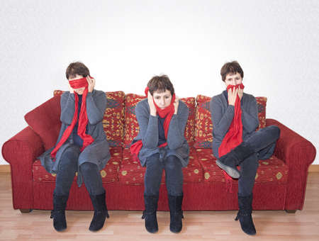 See no evil, hear no evil etc. Woman of certain age with red scarf. Stock Photo