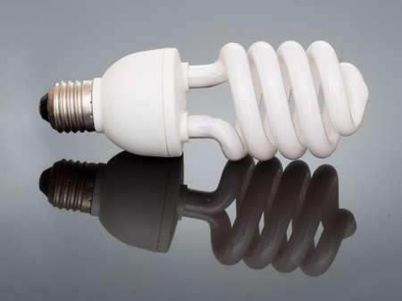 conservation: Energy saving light bulb with reflection