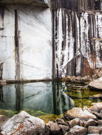 disused: Pool in disused quarry. With algae, reflections etc.