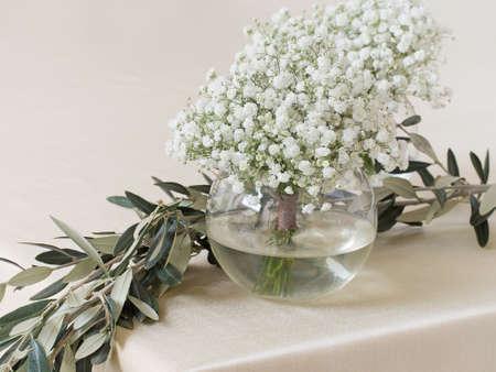 White gypsophila  flowers on table.