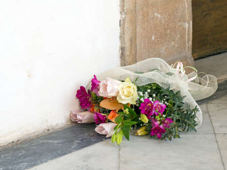 jilted: Beautiful flowers outside church, on the ground. Stock Photo