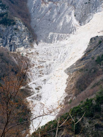 mountainside: Zig zag roads up mountainside. Marble quarry.