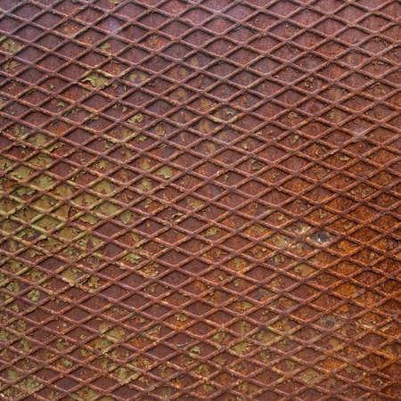 diamond background: Rusty diamond shape background. Some peeling paint. Stock Photo