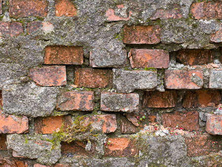 dilapidated wall: Seriously dilapidated old red brick wall