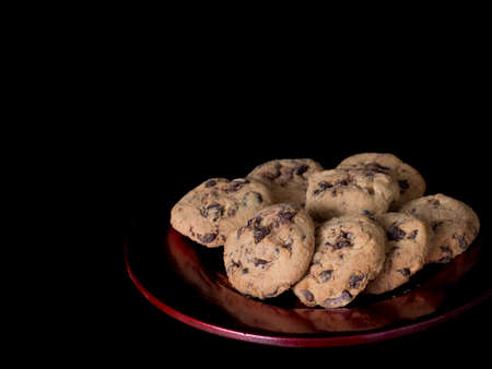 crumbly: Dark dramatic, seductive lighting for delicious crumbly choc chip biscuits.