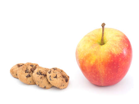 choc: Healthy and unhealthy snack options - chocolate biscuits, apple. On white.
