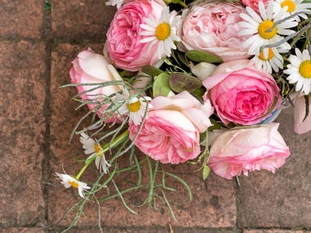 imperfect: Rustic bouquet. With roses, honesty etc. Imperfect, home grown. Stock Photo