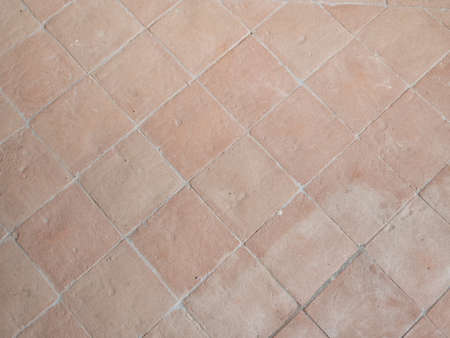 Traditional stone flooring material. Terracotta tiles.