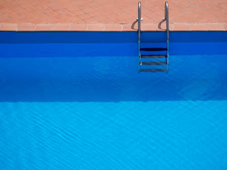 enticing: Swimmn pool with steps. Looks enticing on a hot day.