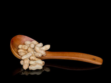Monkey nuts, groundnuts aka peanuts. With copy space.
