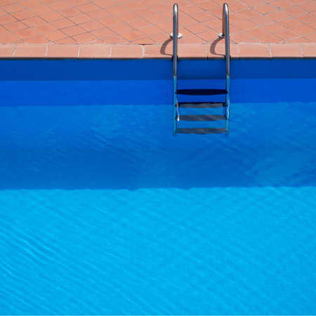 enticing: Swimming pool. Looks enticing on a hot day. Empty.
