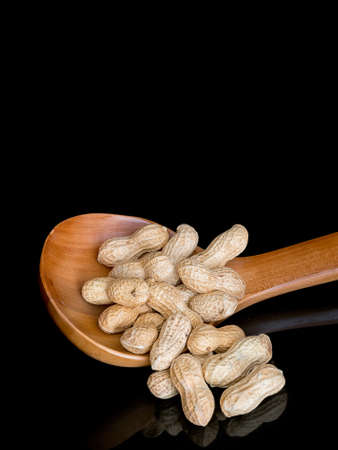 monkey nuts: Peanuts in shells aka monkey nuts. With copy space.