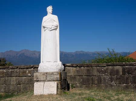 dante alighieri: Statue of Dante Alighieri in Mulazzo, Italy. Sunny day, mountains behind.