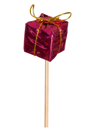git: Decorative party item. Small parcel on stick. Stock Photo