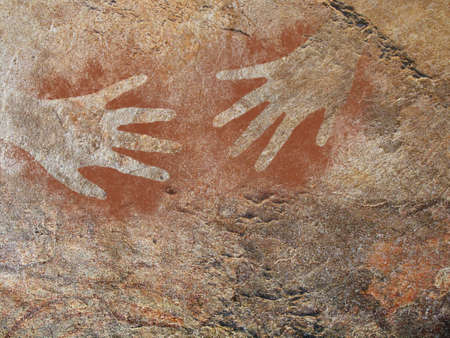 Hand stencil in the style of prehistoric cave art. My hand - twice. Stock Photo
