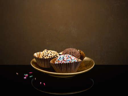 Tempting chocolate truffles - one already eaten.