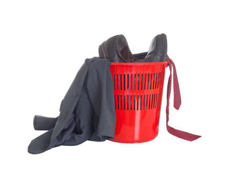 Man's work business suit in rubbish bin. Resign, retired etc, isolated on white.