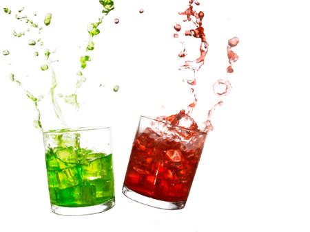 Summer refreshment. Red, green drinks isolated own white. Stock Photo