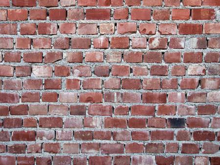 Shoddy work. Red brick wall background. Фото со стока - 85655011
