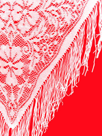 White lace on red.