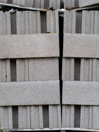 Breeze block stack. Building material, leaning precariously. Stock Photo