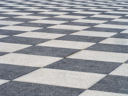 Paved terrace, blackand white tiles. Stock Photo