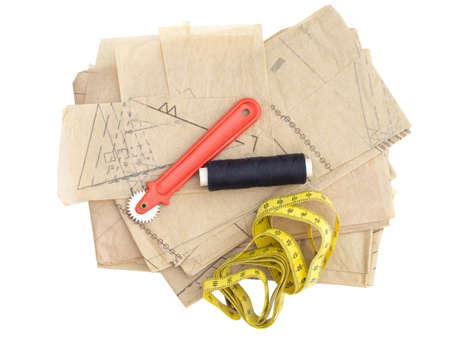 Dressmaking, sewing equipment isolated on white. Paper pattern thread, marker etc.