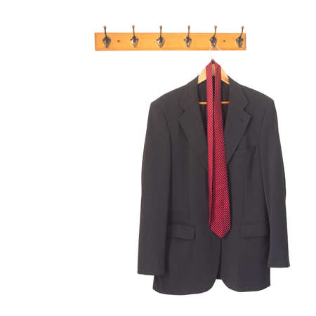 Mans grey suit jacket and tie on hanger, hung up and isolated on white. Retirement, redundancy concept or working late. Stock Photo